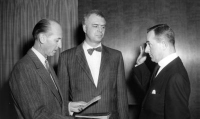 "Swearing-in of United States Ambassador to the Ivory Coast James W. Wine. (L-R) State Department Chief of Protocol Angier Biddle Duke, Assistant Secretary of State for African Affairs G. Mennen ""Soapy"" Williams, and Ambassador Wine."