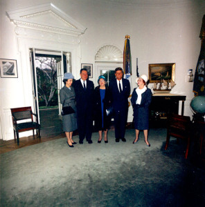 U.S. Congressional Representative from Louisiana Thomas Hale Boggs visiting President John F. Kennedy in the Oval Office along with his wife, Lindy Boggs, and two other unidentified women. White House, Washington D.C., November 5, 1963 [WHP-ST-C380-2-63]