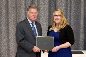 Archivist of the United States David Ferriero presents Kennedy Library volunteer Meghan Testerman with the Weidman Outstanding Volunteer Service Award at Archives II in College Park, MD, 7 May 2014.