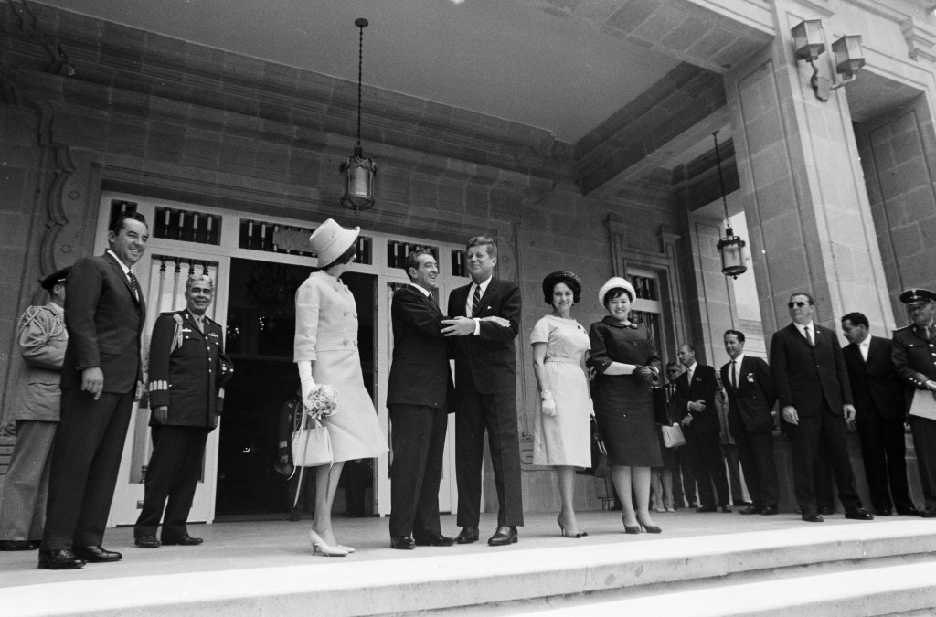 "JFKWHP-ST-300-41-62. President of Mexico, Adolfo López Mateos, welcomes President John F. Kennedy to Los Pinos, the official residence of the President of Mexico. Standing in center (L-R): First Lady Jacqueline Kennedy; President López Mateos; President Kennedy; First Lady of Mexico, Eva Sámano de López Mateos; and Eva López Mateos. Also pictured: Chief of Protocol of Mexico, Federico A. Mariscal; Chief of the Presidential General Staff of Mexico, Major General José Gómez Huerta; U.S. Chief of Protocol, Angier Biddle Duke; U.S. State Department interpreter, Donald Barnes; General Cristóbal Guzmán Cárdenas; White House Secret Service agents, Gerald A. ""Jerry"" Behn, and Paul S. Rundle. Mexico City, Mexico, 29 June 1962."