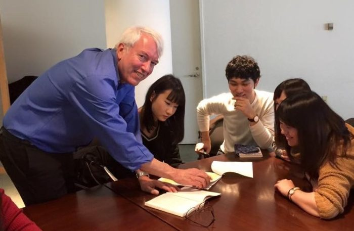 Prof. Robert van Benthuysen assisting students with a Hemingway manuscript, February 2016