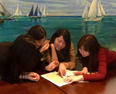Bunkyo Gakuin University students looking at Hemingway materials in the Mural Room, February 2016.