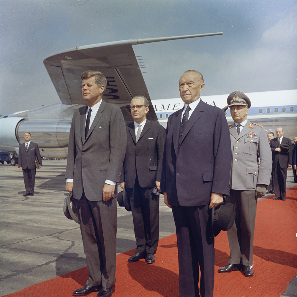 "KN-C29231 23 June 1963 Trip to Europe: Germany, Bonn: Arrival, Konrad Adenauer, Chancellor of West Germany pictured, 9:50AM Please credit ""Robert Knudsen. White House Photographs. John F. Kennedy Presidential Library and Museum, Boston"""