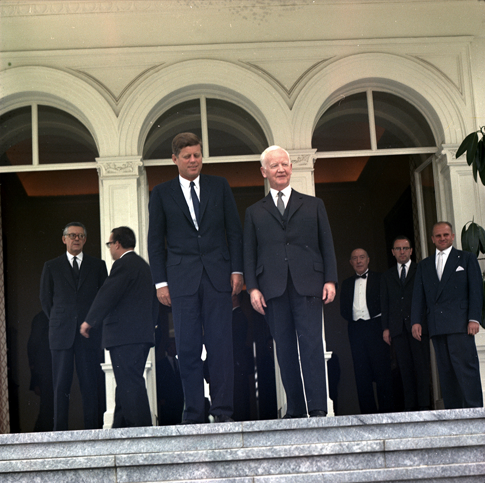 "KN-C29312 24 June 1963 President John F. Kennedy poses on the steps of Villa Hammersmidt with the President of the Federal Republic of Germany Heinrich Luebke and other officials. President Kennedy was attending a meeting with Chancellor Konrad Adenauer during his trip to Gemany. Villa Hammerschmidt, Bonn, Germany. Please credit ""Robert Knudsen. White House Photographs. John F. Kennedy Presidential Library and Museum, Boston"""