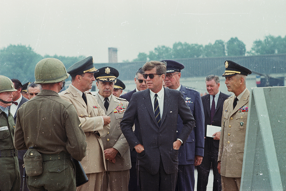 "ST-C230-8-63 25 June 1963 Trip to Europe: Germany, Hanau: Arrival at Fliegerhorst Kaserne, address, and inspection of troops and equipment, 10:45A [Note: Scratches throughout image are original to the negative.] Please credit ""Cecil Stoughton. White House Photographs. John F. Kennedy Presidential Library and Museum, Boston"""