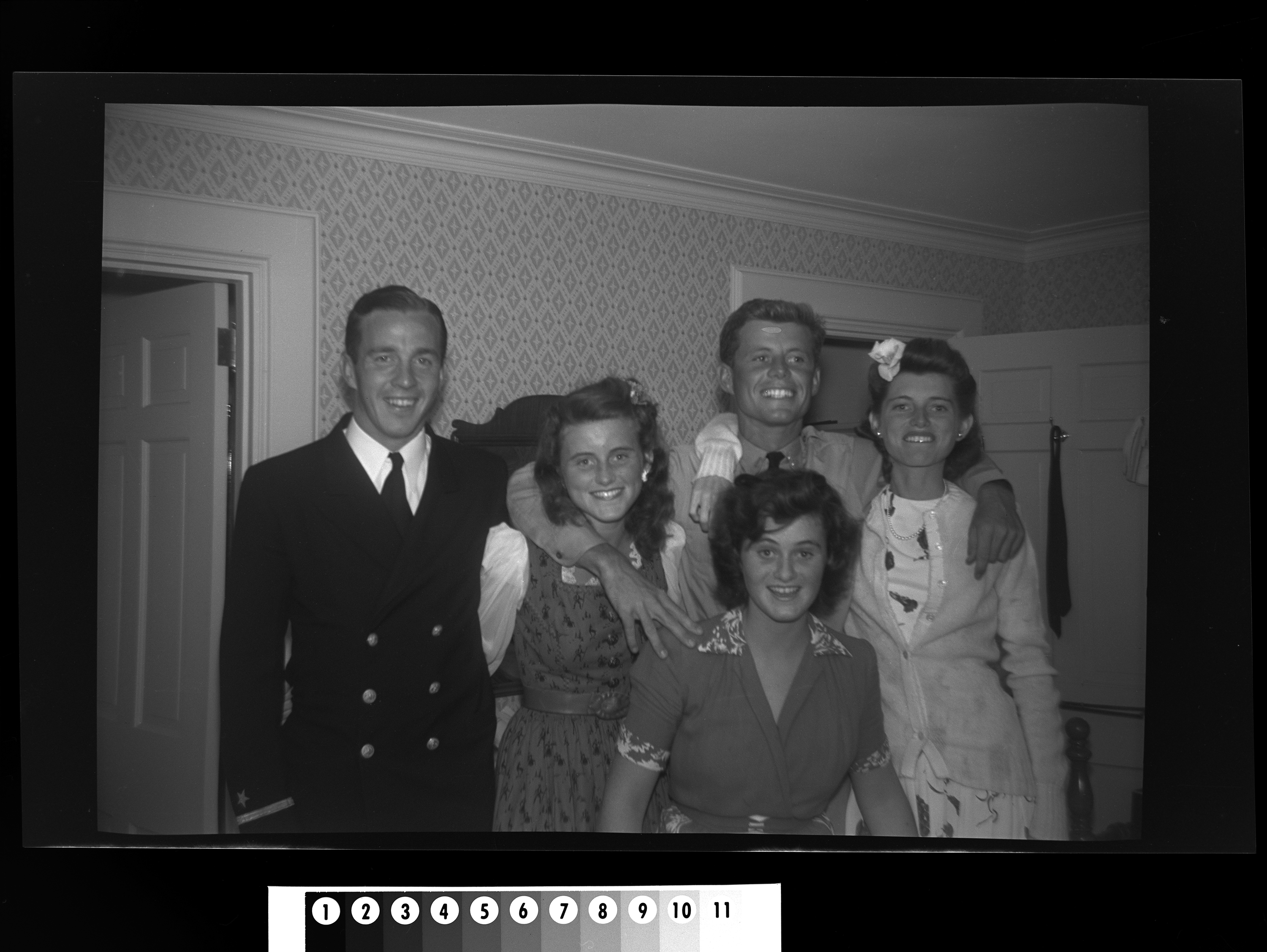 KFC98N. Left to right: Torbert Macdonald, Kathleen Kennedy, John F. Kennedy, Eunice Kennedy, and Jean Kennedy. Hyannis Port, Massachusetts, 1942 1 negative (black-and-white; 2 1/4 x 3 1/4 inches; film/plastic: nitrate) © John F. Kennedy Library Foundation