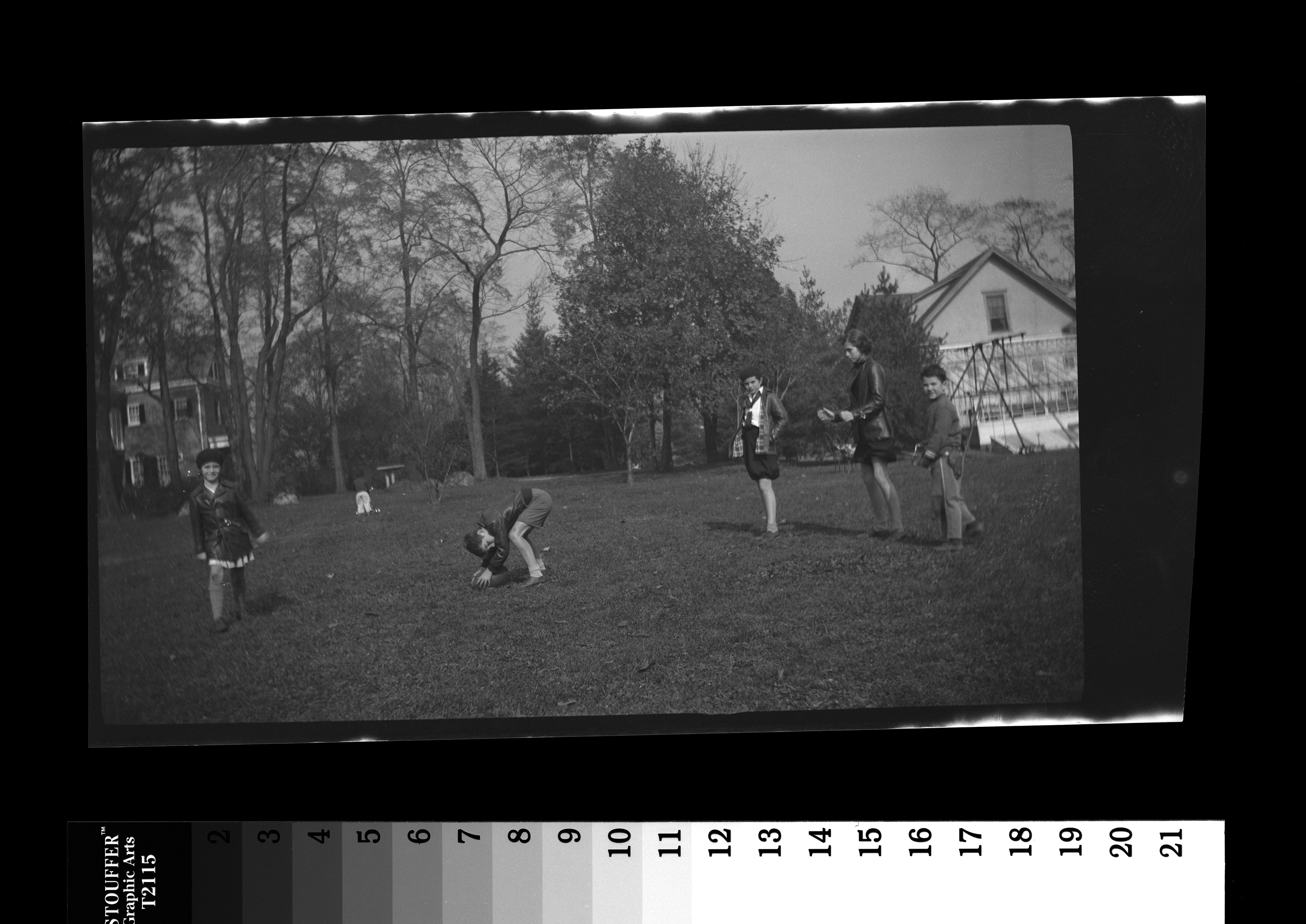 KFC533N. Jean Kennedy, Robert F. Kennedy, Patricia Kennedy, Eunice Kennedy, and an unidentified boy play football. Bronxville, New York, October 1934 1 negative (black-and-white; 2 1/2 x 4 1/4 inches; film/plastic: nitrate) © John F. Kennedy Library Foundation