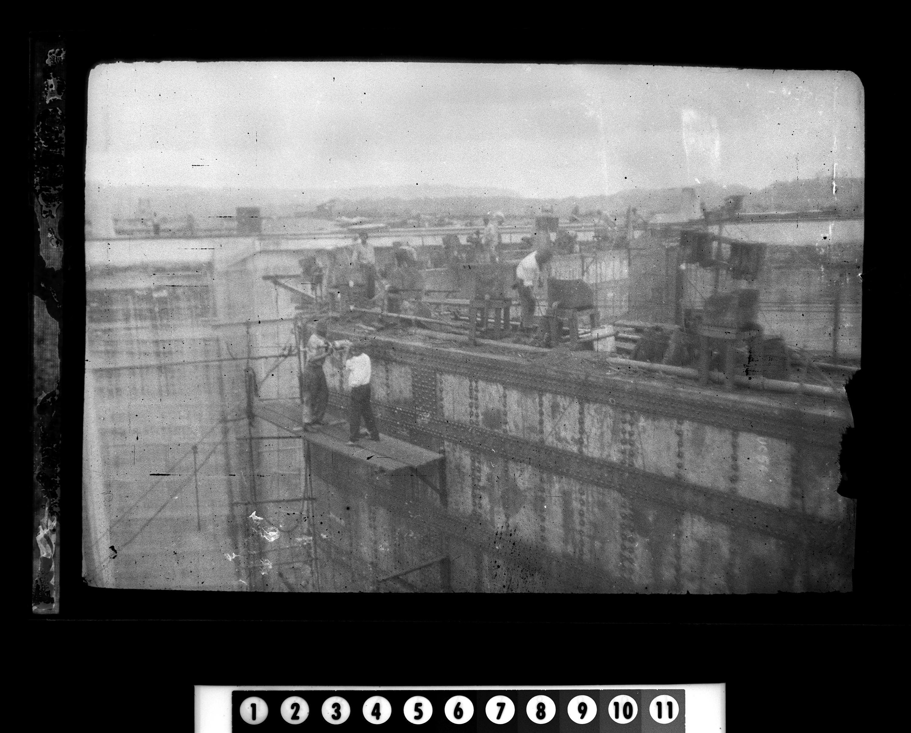 "KFC1576N. ""Canal Construction"" [photograph taken during Rose Fitzgerald's tour of Panama with the Boston Chamber of Commerce]. 1913: April - May 1 negative (black-and-white; 1 5/8 x 2 1/4 inches; film/plastic: nitrate) © John F. Kennedy Library Foundation Boston Chamber of Commerce Tour of Panama, Scenes, 1913: April-May [Spotting and damage are original to the negative.] Photographer unknown. Copyright John F. Kennedy Library Foundation. Kennedy Family Collection. John F. Kennedy Presidential Library and Museum, Boston"