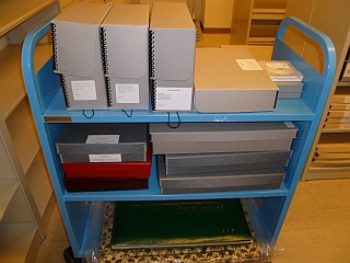 cart of archival boxes