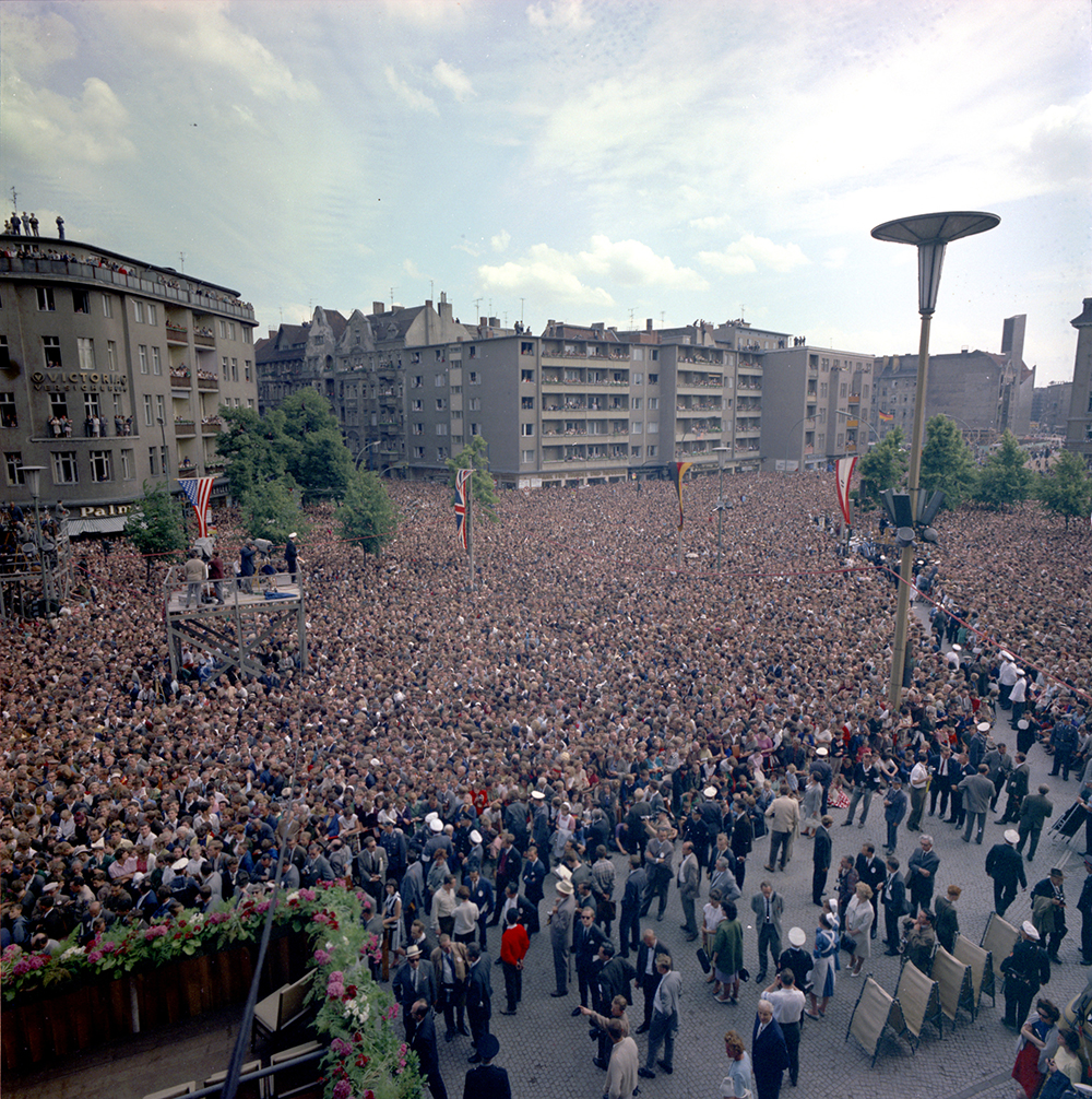 "KN-C29217 26 June 1963 Crowd and cameramen gathered in West Berlin to listen to President John F. Kennedy's address during his trip to Germany. Rathaus, West Berlin, Germany. Please credit ""Robert Knudsen. White House Photographs. John F. Kennedy Presidential Library and Museum, Boston"""
