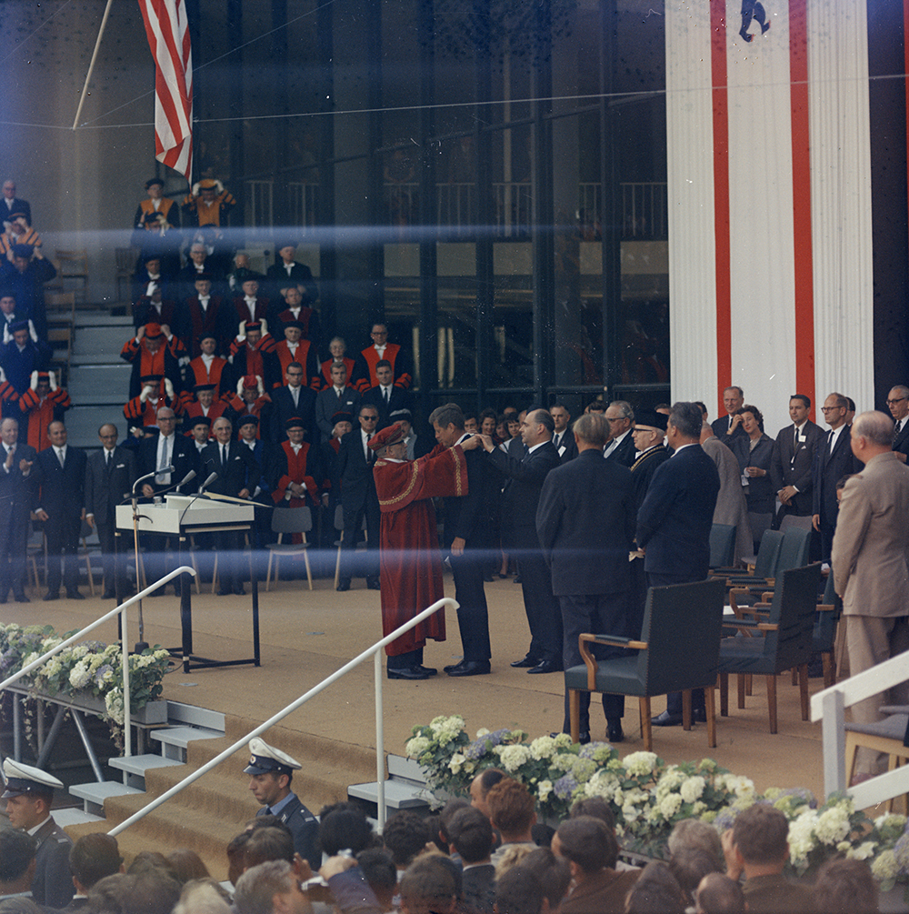 "KN-C29292 26 June 1963 Trip to Europe: Germany, West Berlin: President Kennedy addresses Free University, 3:30PM [Note: Horizontal streaks are original to the negative.] Please credit ""Robert Knudsen. White House Photographs. John F. Kennedy Presidential Library and Museum, Boston"""