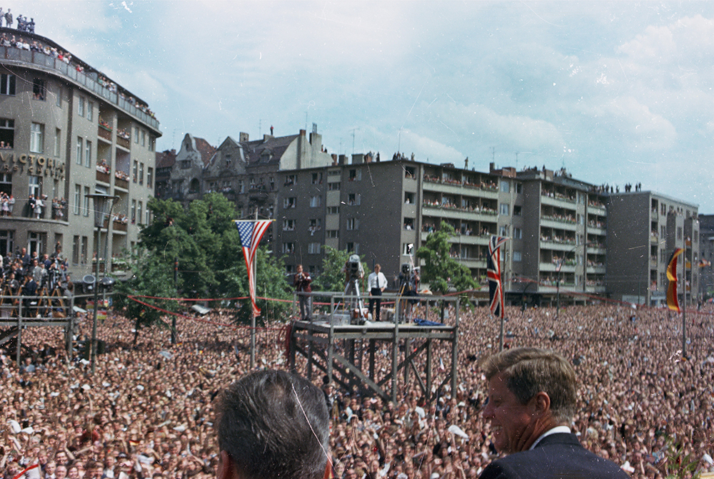"ST-C230-17-63 26 June 1963 Trip to Europe: Germany, West Berlin: President Kennedy addresses crowd at Rathaus Schöneberg, 12:50PM [Scratches throughout image are original to the negative.] Please credit ""Cecil Stoughton. White House Photographs. John F. Kennedy Presidential Library and Museum, Boston"""